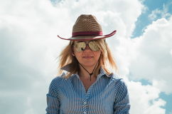 Pretty woman in cowboy hat. Outdoors Royalty Free Stock Photos