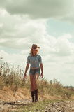 Pretty woman in cowboy hat. Outdoors Royalty Free Stock Photography