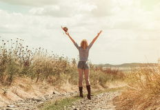 Pretty woman in cowboy hat. Outdoors Royalty Free Stock Image
