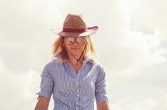 Pretty woman in cowboy hat Stock Photography