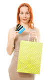 Pretty woman with credit cards and shopping. Pretty woman with many different credit cards and shopping on white background Royalty Free Stock Photography