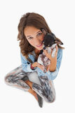 Pretty woman cuddling her chihuahua Stock Photography