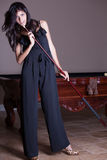 Pretty woman and cue stick Royalty Free Stock Image