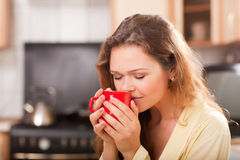 Pretty woman with cup of tea Royalty Free Stock Images
