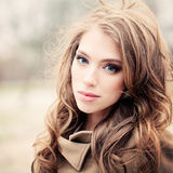 Pretty Woman with Curly Hair Outdoors Royalty Free Stock Photography