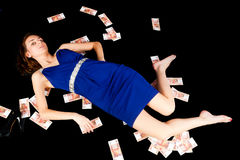 Pretty woman with currency Royalty Free Stock Photos