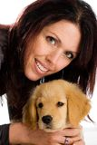 Pretty Woman with a cute fluffy puppy. Royalty Free Stock Photos