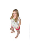 Pretty woman in cute spring outfit and bare feet. Pretty young woman in cute spring outfit Royalty Free Stock Image