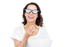 Pretty woman with 3D glasses eating popcorn Stock Image