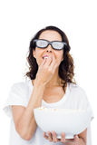 Pretty woman with 3D glasses eating popcorn Stock Photos