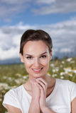 Pretty woman on a daisies meadow Royalty Free Stock Photo