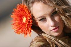 Pretty woman with daisy Stock Photo