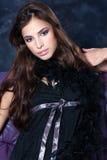 Pretty woman on dark background Royalty Free Stock Photos