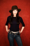 Pretty woman in a dark hat Royalty Free Stock Photos