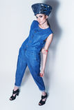 Pretty woman in denim hat and jumpsuit Royalty Free Stock Image