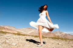 Pretty woman in desert Stock Images
