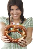 Pretty woman with dirndl and pretzel. Isolated on white royalty free stock photography
