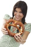 Pretty woman with dirndl and pretzel. Isolated on white stock photo