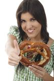Pretty woman with dirndl and pretzel. Isolated on white Stock Photos