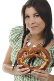 Pretty woman with dirndl and pretzel. Isolated on white royalty free stock photos