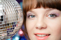 Pretty woman and disco ball Royalty Free Stock Photography