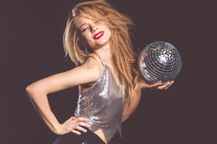Pretty woman with disco ball in hands Stock Photos