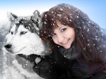 Pretty woman and dogs siberian husky Stock Images