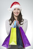 Pretty woman doing Christmas shopping Royalty Free Stock Images