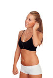 Pretty woman doing fitness listening music with headphones royalty free stock photo