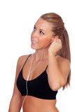 Pretty woman doing fitness listening music with headphones Stock Photos