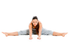 Pretty woman doing flexibility exercise. Isolated on white background Stock Photography