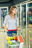 Pretty woman doing her grocery shopping Stock Photos
