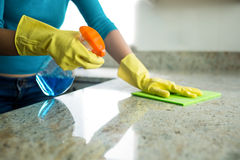 Pretty woman doing her house chores. At home royalty free stock photography