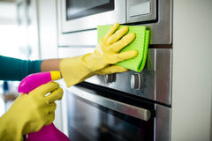 Pretty woman doing her house chores Royalty Free Stock Photos