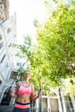 A pretty woman doing jumping rope Royalty Free Stock Photos