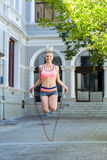 A pretty woman doing jumping rope Royalty Free Stock Images