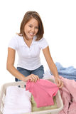 Pretty Woman Doing Laundry Royalty Free Stock Images