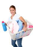 Pretty Woman Doing Laundry. A pretty young woman doing laundry at home Royalty Free Stock Photo