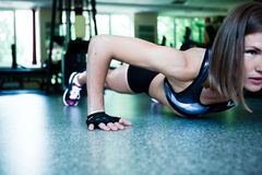 Pretty woman doing push-ups in the gym Royalty Free Stock Photo