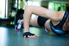 Pretty woman doing push-ups in the gym Stock Photography