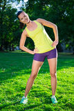Pretty woman doing sport exercises in morning park Royalty Free Stock Photo
