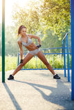 Pretty woman doing sport stretching exercises and relax Royalty Free Stock Photography