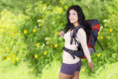 Pretty woman doing trekking in woods Royalty Free Stock Photography