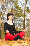 Pretty woman doing yoga exercises Royalty Free Stock Images