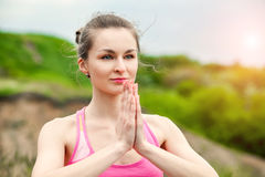 Pretty woman doing yoga exercises on nature landscape Royalty Free Stock Photos