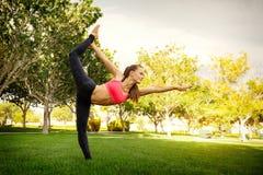 Pretty woman doing yoga exercises Stock Photography