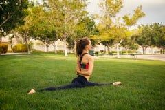 Pretty woman doing yoga exercisies Stock Image