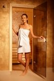 Pretty woman at door of sauna Stock Photos