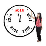 Pretty woman drawing annual clock Stock Images