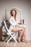Pretty woman in a dressing-gown and curlers Stock Images